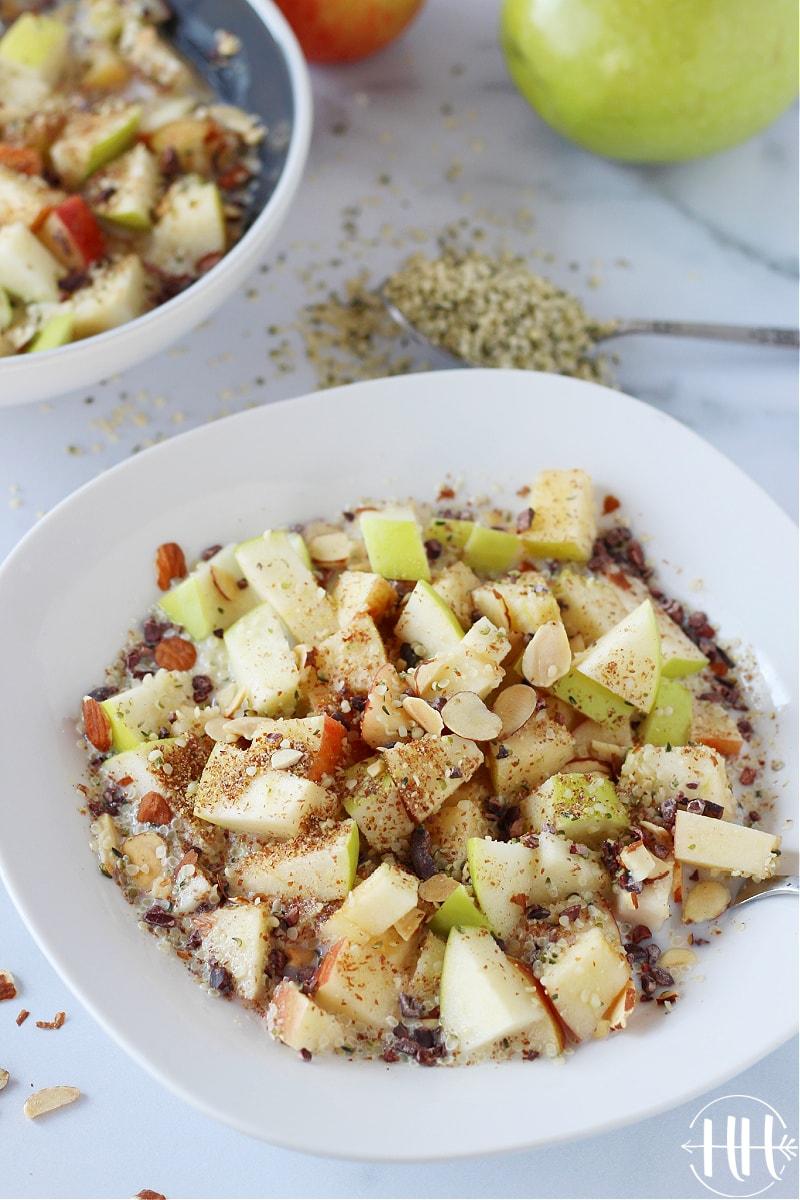 Beautiful bowls of vegan apple cereal with Manitoba Heart hemp seeds.