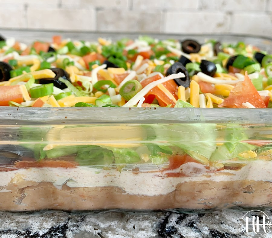 Need an easy, healthy and fun dish to take to your next potluck or party? This taco dip does not disappoint with it's fresh and bold flavors. Who doesn't love layers of fresh ingredients piled high? You may have made a dip similar to this in the past, but have you used layers of freshly sliced avocados or Greek yogurt? The fresh ingredients in this dip are really what make it shine.