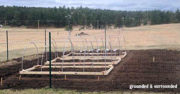 My husband built me 3 hoop houses out of 2x4's and pvc pipe last year. We are hoping to build some season-extending low tunnels this season. This is such a versatile product to use in your garden, and SO CHEAP! http://www.groundedandsurrounded.com/frugal-diy-garden-articles/