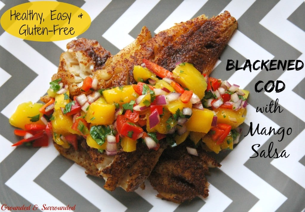 This healthy grilled cod with colorful mango salsa comes together SO quickly! Aren't easy weeknight meals the best? The smokey spiciness of the fish paired with the sweet yet tangy salsa is a flavor explosion! This simple, gluten-free, and clean-eating recipe is sure to impress. Who says healthy food is boring?! Not us! http://www.groundedandsurrounded.com/recipe/blackened-cod-with-mango-salsa/