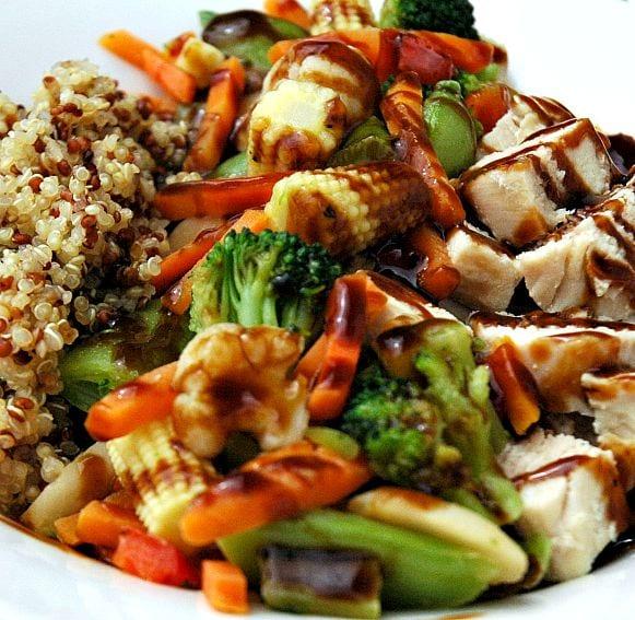 Tri color quinoa, teriyaki vegetables, and chicken breast with a teriyaki glaze.