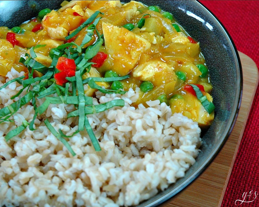 Fall recipes: A bowl of Sweet & Spicy Turkey Curry from HappiHomemade.com with a side of rice.