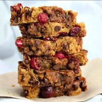 "These gluten free Cranberry Chocolate Chip Bread loaves are a sweet and easy treat to bake! Baking your favorite recipes is always fun, especially during the holidays! The fresh tart cranberries are tamed by the addition of mini chocolate chips and coconut sugar. Grab the bag of frozen cranberries you bought during Christmas and bake this healthy quick bread. This is the best ""healthified"" cranberry bread I have found!"