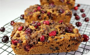 """These gluten free Cranberry Chocolate Chip Bread loaves are a sweet and easy treat to bake! Baking your favorite recipes is always fun, especially during the holidays! The fresh tart cranberries are tamed by the addition of mini chocolate chips and coconut sugar. Grab the bag of frozen cranberries you bought during Christmas and bake this healthy quick bread. This is the best """"healthified"""" cranberry bread I have found!"""