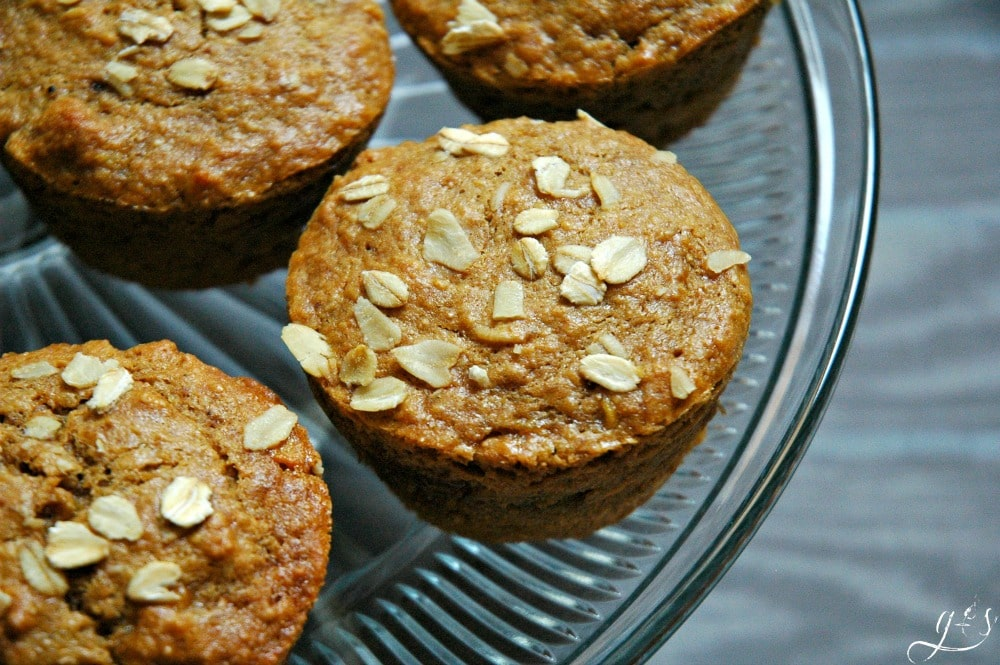 """These easy Chunky Monkey Muffins have a surprise twist! Not only does this healthy breakfast recipe contain bananas, peanut butter (or PB2), and oatmeal...but a surprise chocolate center! If you want to """"WOW"""" your friends and family with a new recipe this is it! It's a fun idea for kids after school snacks too! These also contain simple and nourishing ingredients such as coconut oil, coconut sugar, and oats!"""