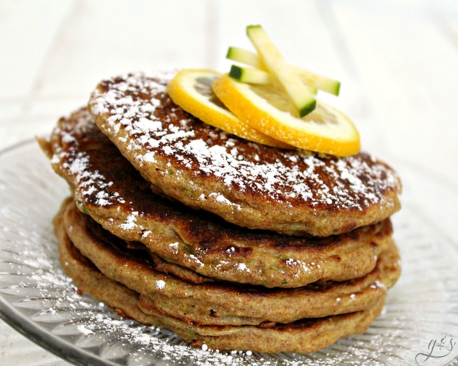 The Best Lemon Zucchini Pancakes | This delicious recipe is perfect for an easy school day breakfast for the kids. These simple from scratch flapjacks are just what you need to make your morning easy. Try freezing half the batch of these healthy, homemade, & whole wheat pancakes to eat later. The combination of healthy zucchini and fresh lemon create a sweet and easy pancake perfect for any family meal!