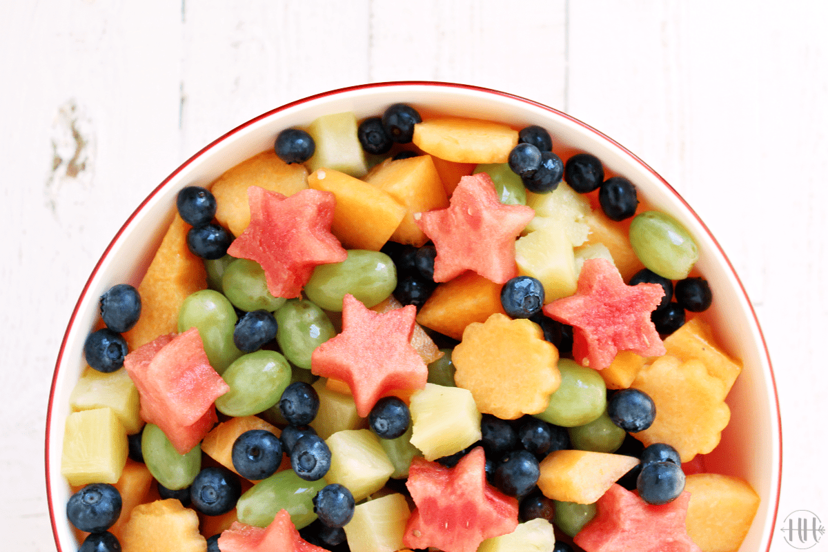 Fruit Salad with fresh ingredients and cute melon shapes like flowers and stars.