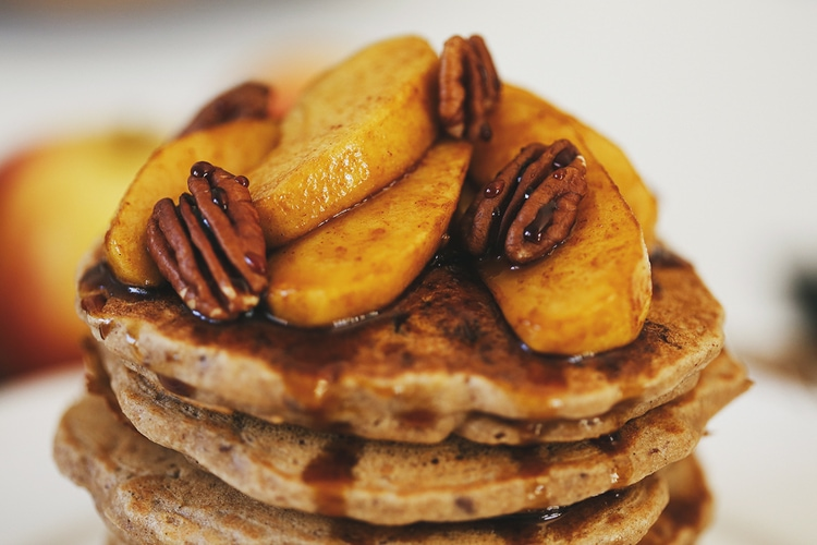 Tall stack of Apple Buckwheat Pancakes with Coconut Caramel Apples from Cocoon Cooks.