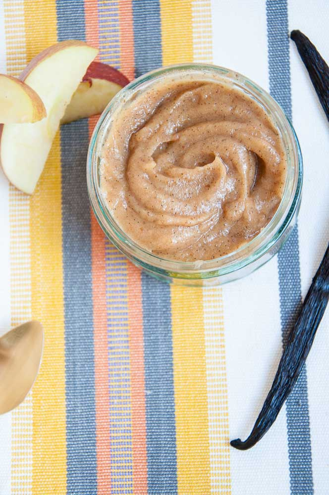 Creamy Healthy Caramel Dip from Vegan Family Recipes surrounded by apple slices and vanilla bean.