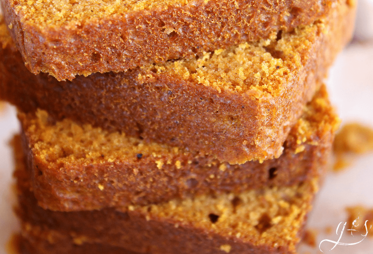 Grandma's Pumpkin Bread Recipe | This is the best fall bread recipe and has been passed down for generations. I have made it a little more healthy than the original, but is just as moist and delicious. Add chocolate chips or an easy streusel topping to make it even more special. It also makes the most amazing muffins, just reduce the time! Homemade and simple never tasted so good! PS...Feel free to use all purpose flour or whole wheat!
