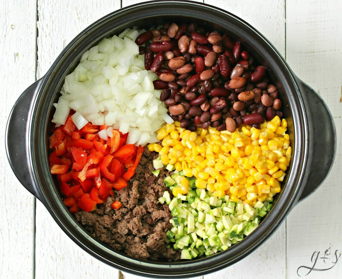 Whole Food Family Recipes: Taco Soup ingredients in sections in a large black Dutch oven.