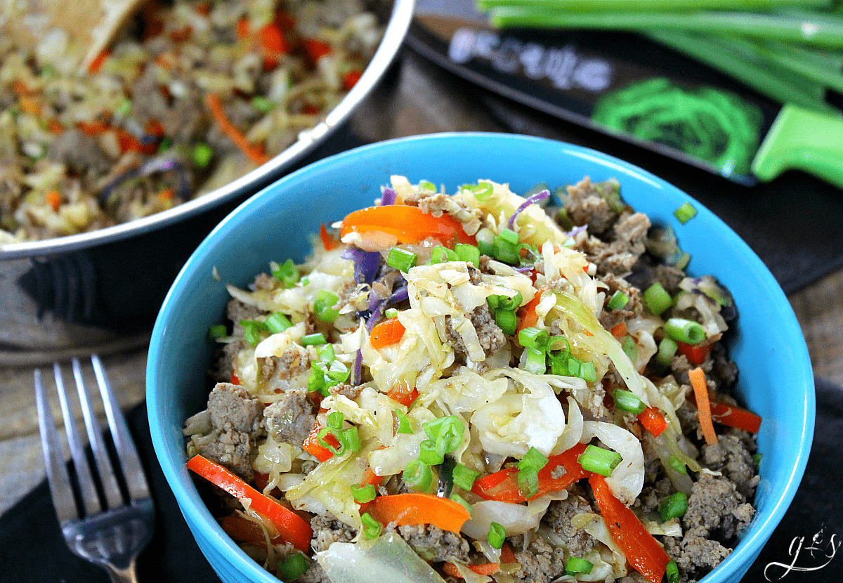 7 Ingredient Skinny Egg Roll Bowl | Chinese food in a bowl is always a winner, but easy and healthy Chinese recipes are even better. This clean eating, vegetable packed, turkey sausage (or pork) combination is sure to cure any takeout cravings you have. Whether you are following Whole 30, low carb, Weight Watchers, 21 Day Fix, Paleo, or Thm (Trim Healthy Mama), you will love the newest gluten free recipe on the block!