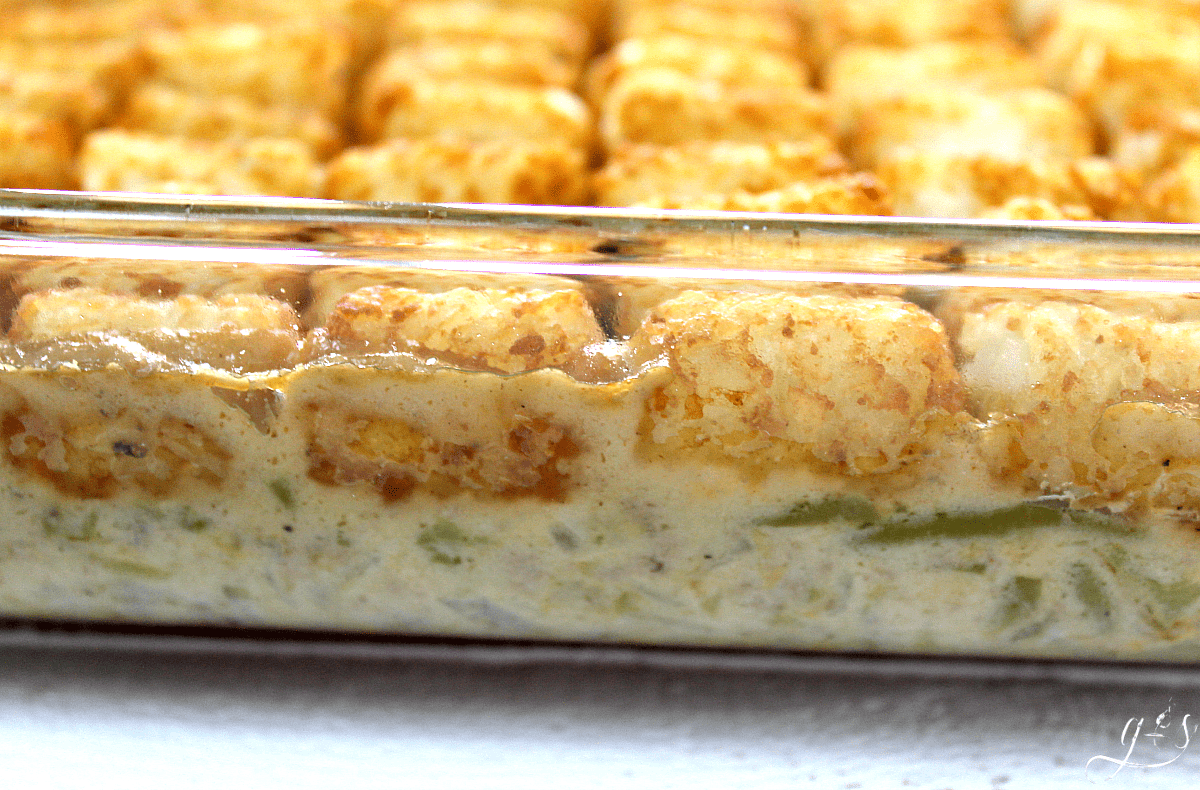The BEST Gluten-Free Tater Tot Casserole | This easy original recipe will quickly become your family's favorite meal! Only 10 simple ingredients like ground beef, milk, green beans, and tater tots combine into a gluten-free recipe that is more healthy than the cream soup variety. Lightened up comfort foods can taste delicious! Let's feed our families dinners and dishes that offer more nutrition while still saving money and living a frugal lifestyle.