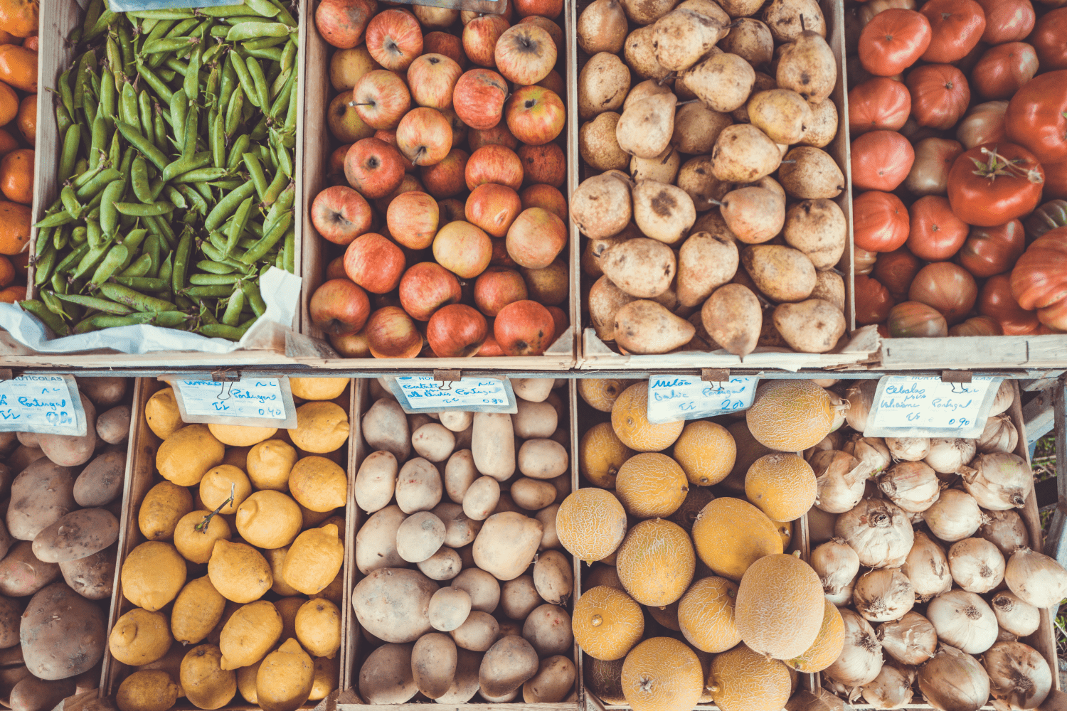 A market with bins full of fresh produce is where to go to learn how to eat more whole foods.