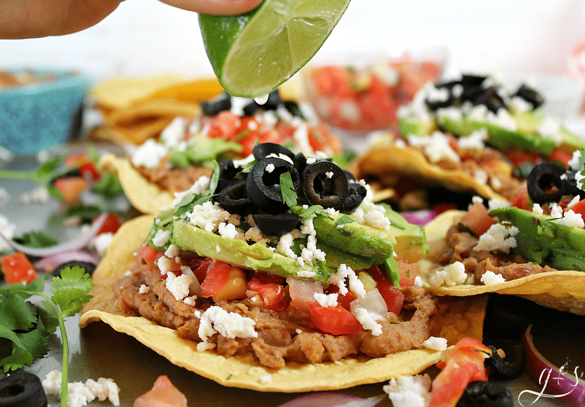 Healthy vegetarian tostadas drizzled with fresh lime juice.