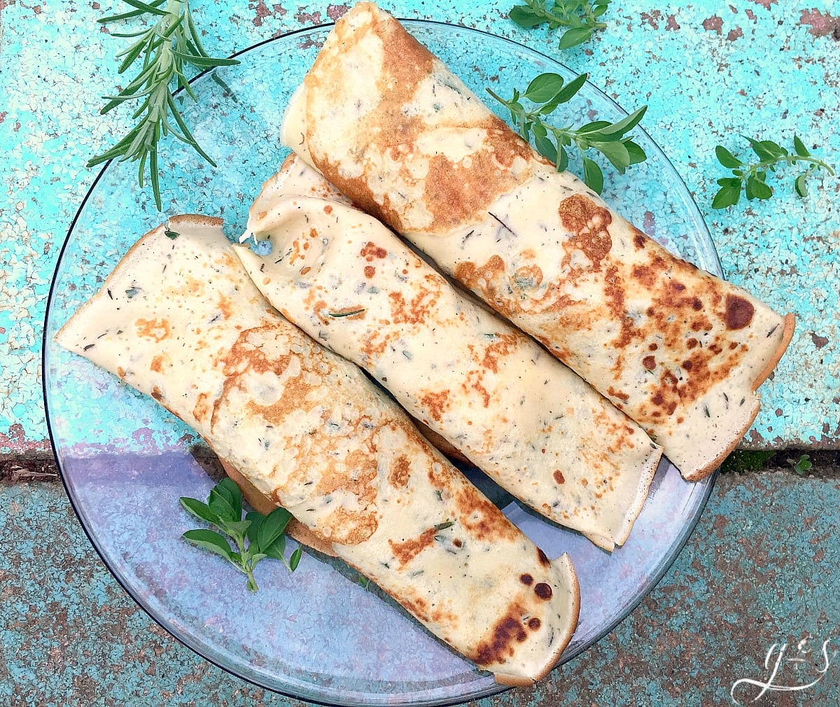 Savory Vegetarian Crepes | A batch of these thin, savory pancakes with pan-roasted mushrooms, a handful of fresh garden herbs and spoon or two of creamy chèvre will make you reconsider your sweet crepes recipes. This filling and healthy breakfast or brunch will have you singing! Everyone, especially vegetarians, will love this delicious and fun meal idea.