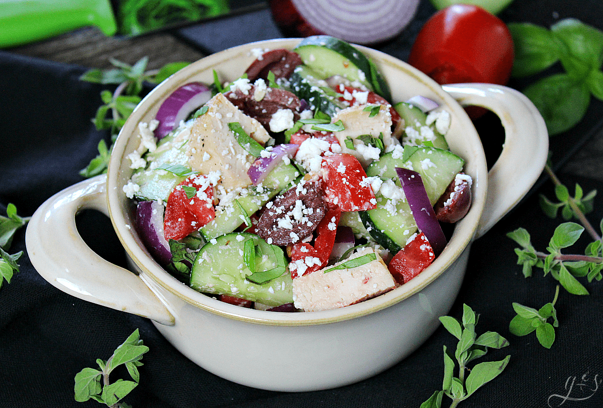 The BEST Skinny Greek Salad | This healthy and clean eating salad is easy, authentic, and ahhhhmazing! Throw together all the veggies, grilled chicken, herbs, cheese, and olives then go crazy with the dressing. Use balsamic vinegar, extra virgin olive oil, and salt and pepper to make this a truly delicious dinner or gluten-free lunch. Add cooked quinoa to make it vegetarian or omit the chicken and quinoa and serve as a chopped salad side dish. 21 Day Fix | Vegan Meal Version | Simple