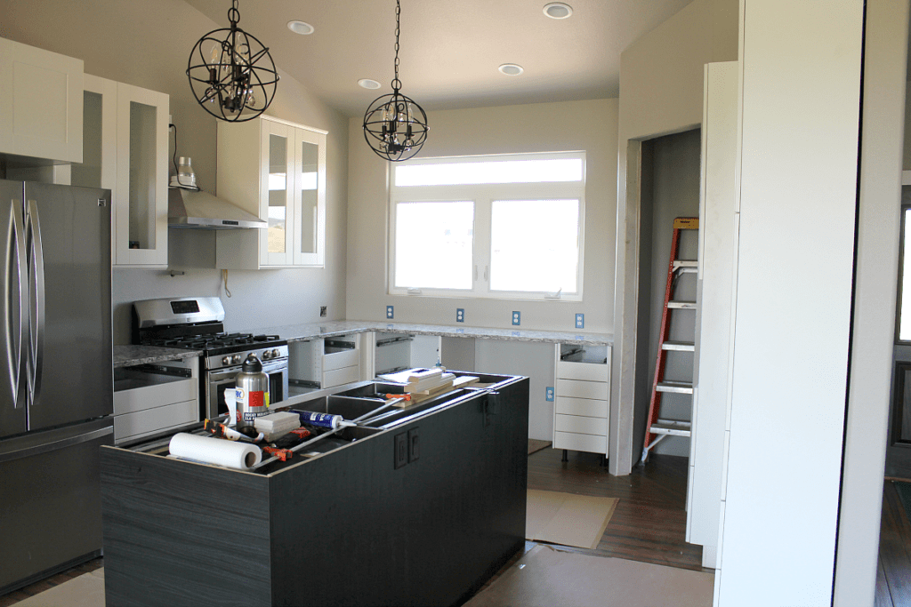 New Kitchen: Cambria Quartz in Bellingham, Island Pendants from Wayfair, Ikea cabinets, Sears Kenmore appliances.