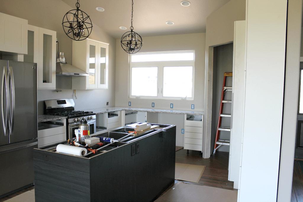 New Kitchen: Cambria Quartz in Bellingham, Island Pendants from Wayfair, Ikea cabinets, Sears Kenmore appliances.