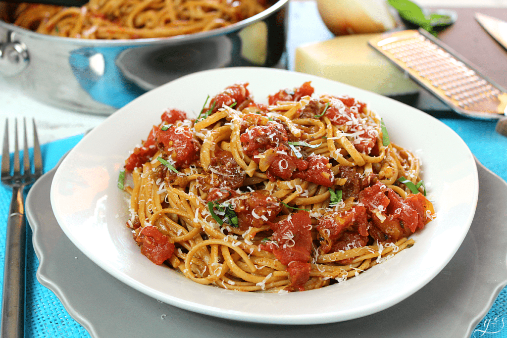 The BEST Amatriciana and Linguine | This easy pasta sauce recipe uses bacon, tomatoes, onions, garlic, and red chile pepper flakes to make a unique meal atop linguine, bucatini, spaghetti, or penne. Dinners like this can be made healthier, gluten-free, and clean eating by using spaghetti squash or sauteed veggies. Comfort food at it's finest with this simple and traditional Roman and Italian dish!