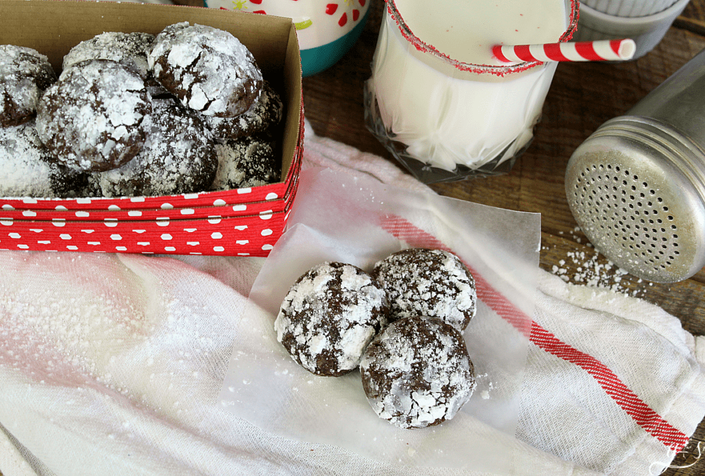 The BEST Gluten Free Chocolate Crinkle Cookies | This easy from scratch recipe uses gluten free flour, coconut sugar, and coconut oil. This bite-sized cookie is perfect for Christmas, the holidays, or any time of the year! This fudgy version is more healthy than the regular even with the small amount of powdered sugar. They are soft, moist, and chewy AND it will be so hard to stop at just one!