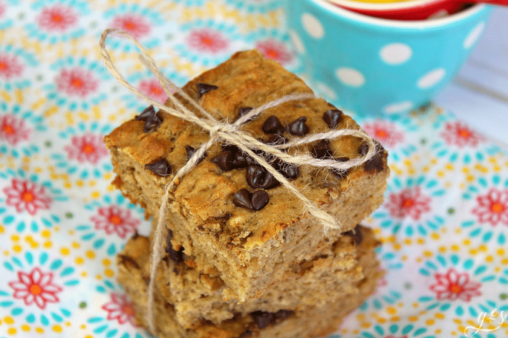 Banana Bread Blondies stacked 3 high with a string tied in a bow around them.