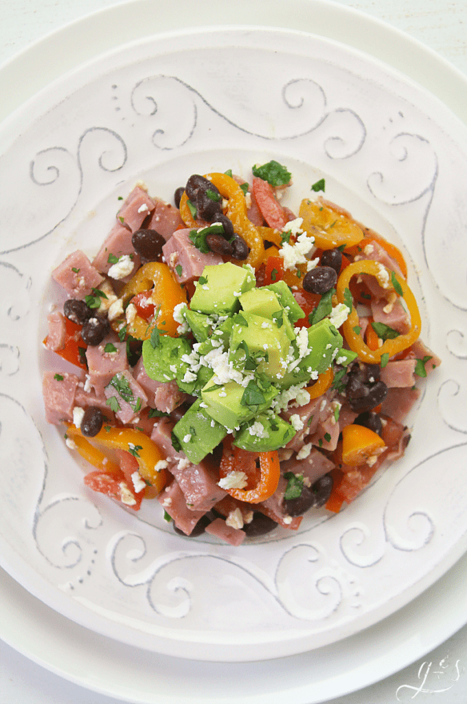 The BEST Ham Black Bean & Veggie Salad | Do you need to use up some leftover ham or have some fresh vegetables that will go bad? This clean eating and gluten-free salad is just the recipe for you! Healthy and easy recipes like this using whole foods are perfect for weightloss. There is only one dressing ingredient too: extra virgin olive oil! Summer parties need this summer salad too! #recipes #lunch #Easter