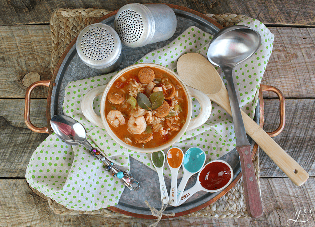 Overhead photo of a Cajun recipe staged on a metal tray.