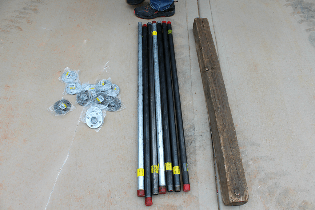 Flanges, steel pipe, and posts to make rustic stair banister.