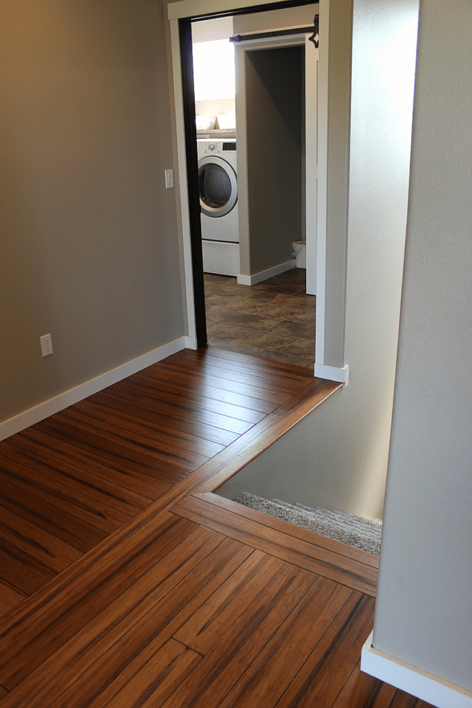 A wood floor hallway in need of a rustic stair banister.