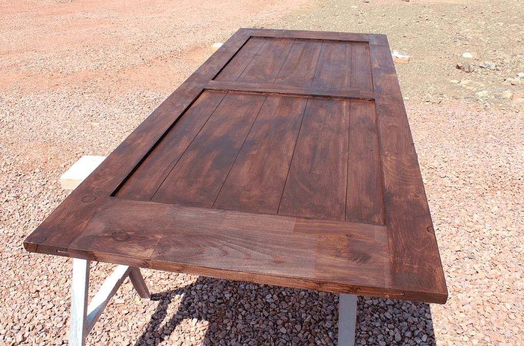 first coat of walnut gel stain on barn door