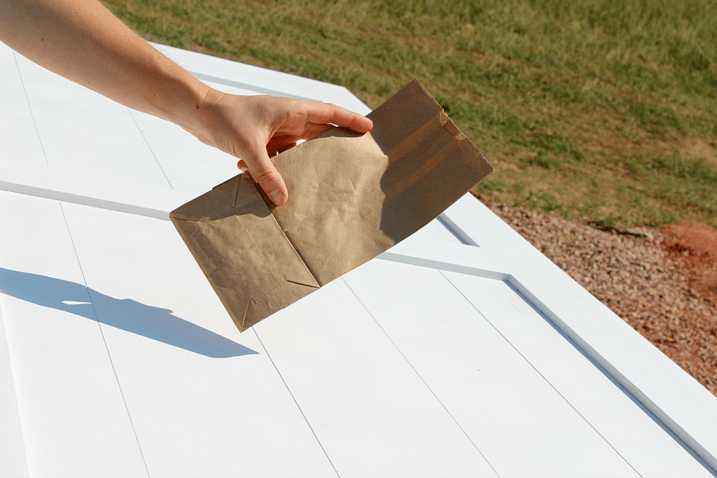 Small brown paper bag used to buff out wax on door.