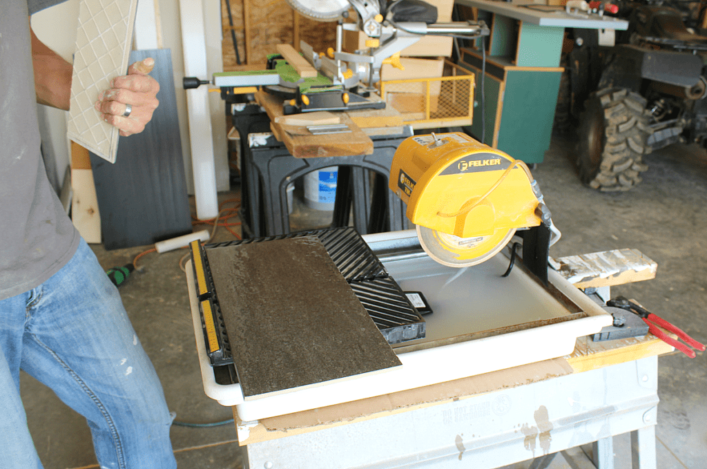Wet saw to cut ceramic tile with it's own water pump.