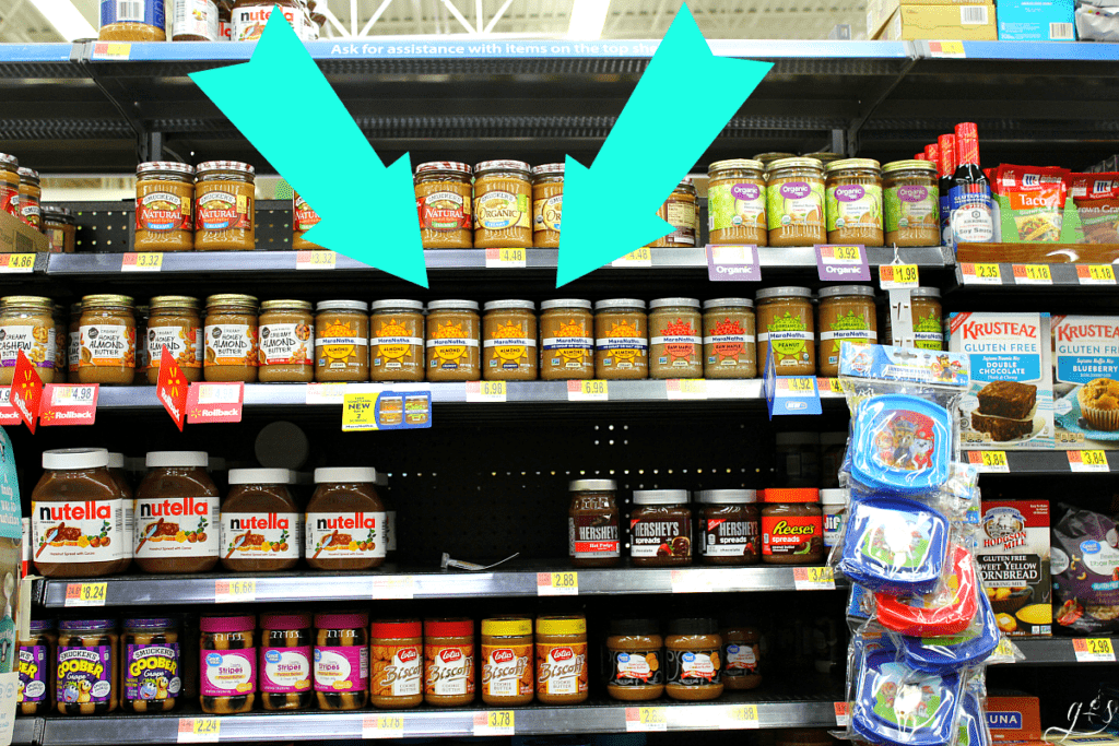 A photo of MaraNatha Almond Butters on the shelf at Wal-Mart with the other nut butters, honey, and jellies.