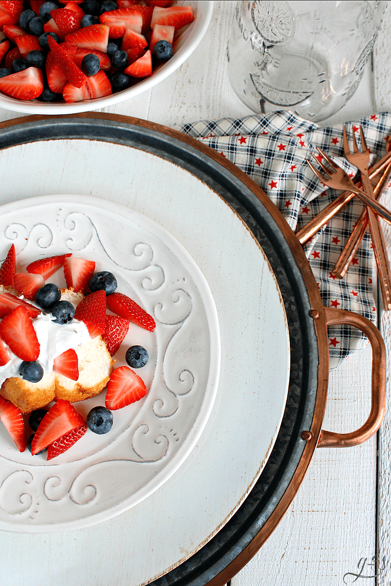 The BEST Patriotic Shortcake | Your July 4th, Memorial Day, and Labor Day parties just got a whole lot better with this easy dessert option! Buy an angel food cake, fresh strawberries, blueberries, and a can of full-fat coconut milk or coconut cream. This healthy dairy-free recipe is the easiest way to have a themed dessert for your next American freedom bbq. Plus, homemade whipped cream is always the best! Patriotic food ROCKS! #summer #dessert #america
