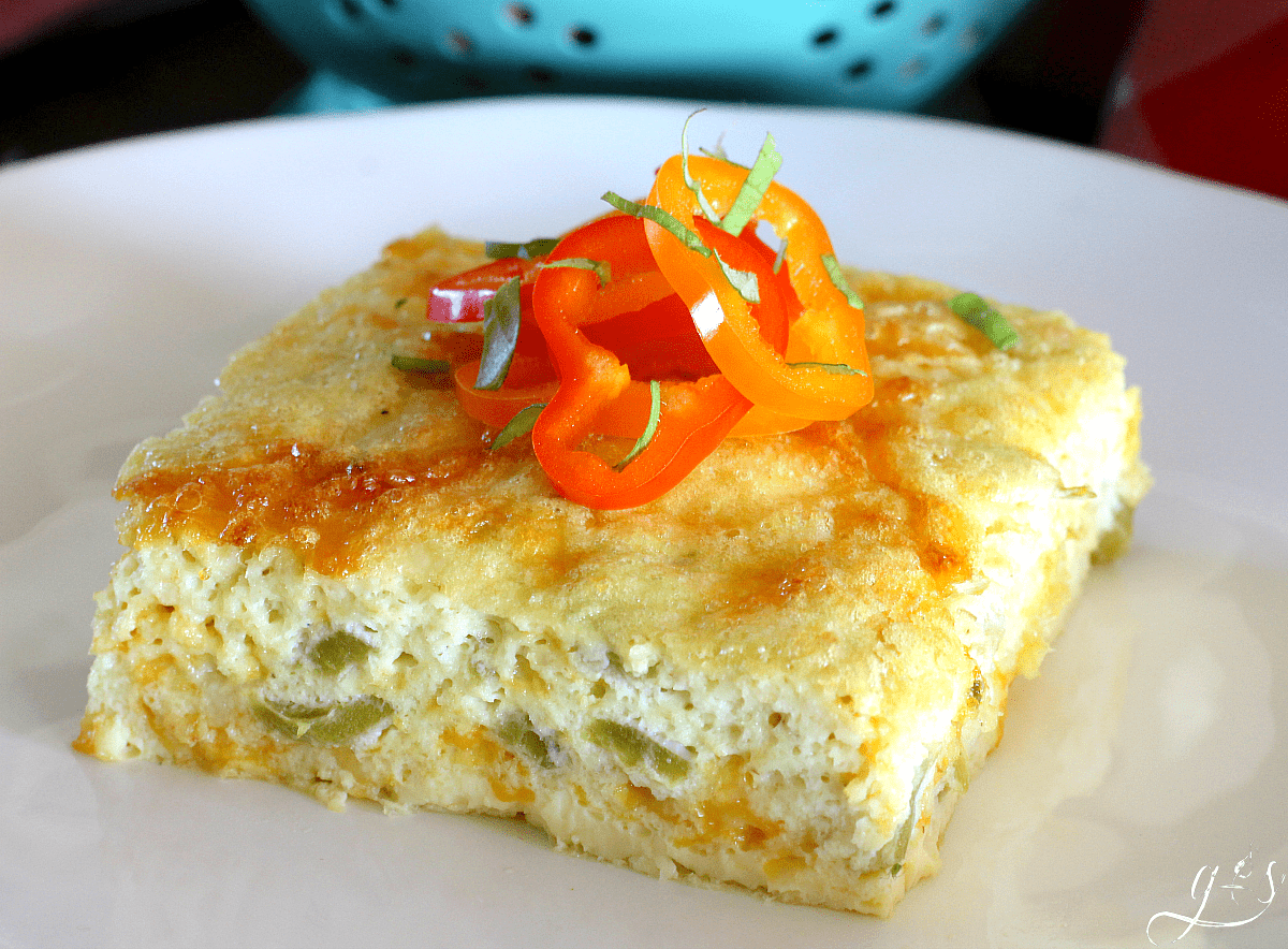 Beautiful shot of a slice of an egg bake using canned green chiles, pepper jack cheese, and oat flour.