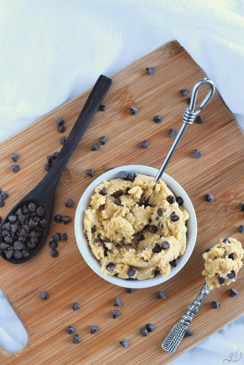 Birds eye view of a dairy free and gluten free edible cookie dough in a white bowl.