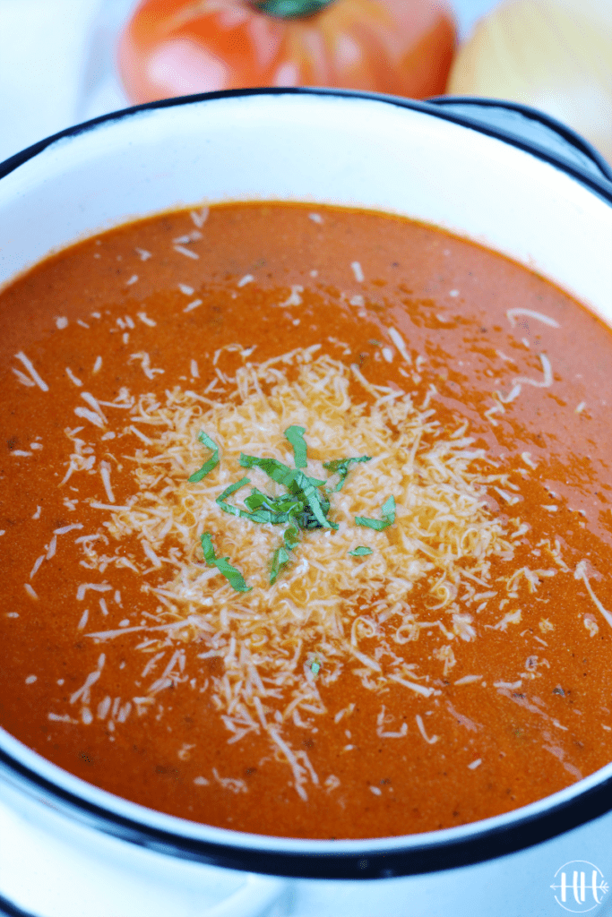 The BEST Creamy Tomato Basil Soup | This easy homemade recipe is packed full of flavor thanks to the fresh basil, canned fire roasted tomatoes, and half and half. You can use fresh tomatoes if you blanch and peel them. Blend the soup with a stick blender or food processor. Low carb soup recipes like this are quick, simple, and healthy. Don't you just love a fast dinner recipe? Enjoy with a grilled cheese sandwich! :) #soup #cleaneating #lowcarb