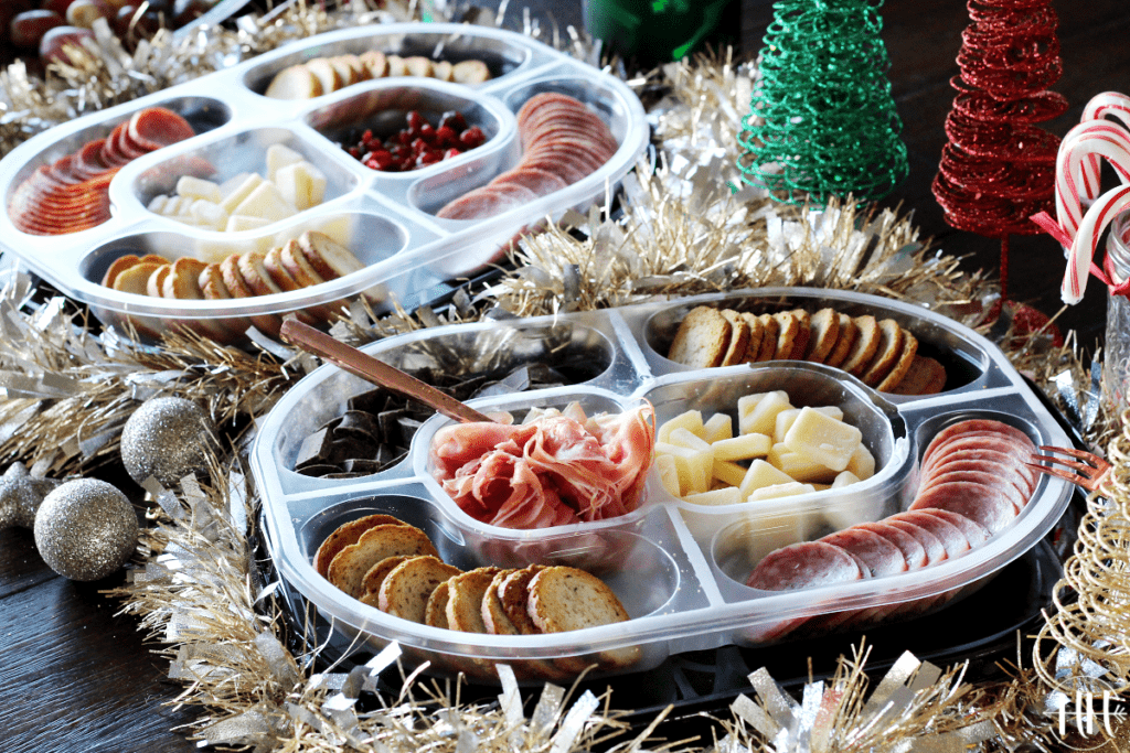 Hillshire Snacking Social Platters on a table decorated for the holidays.