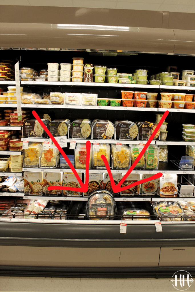 Refrigerated section of Target highlighting snack trays of meat and cheese.