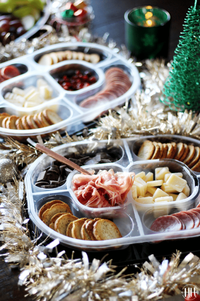 Hillshire Snacking Social Platters: Genoa Salame & Prosciutto with Christmas garland around it.