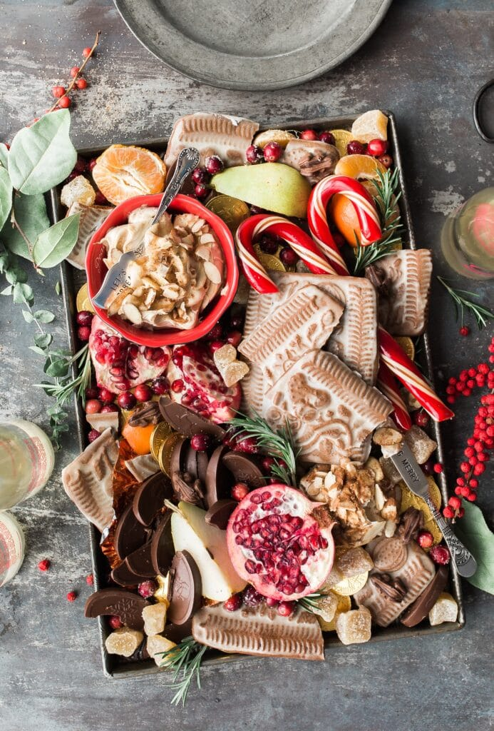 Holiday charcuterie board with delicious food for Christmas dinner.