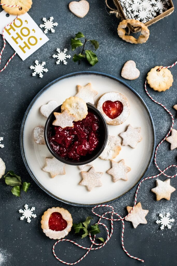 Christmas cookies with jam and plated beautifully.