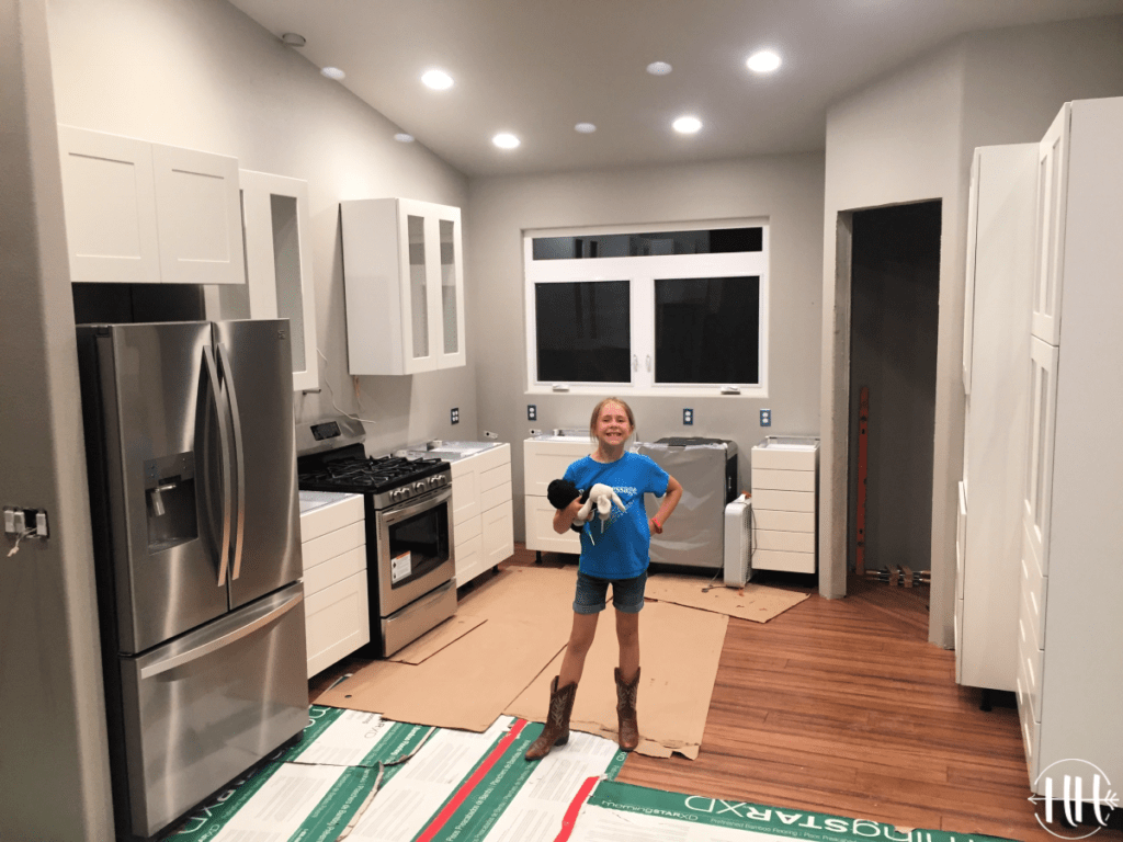 Proud daughter in her family's new IKEA kitchen.