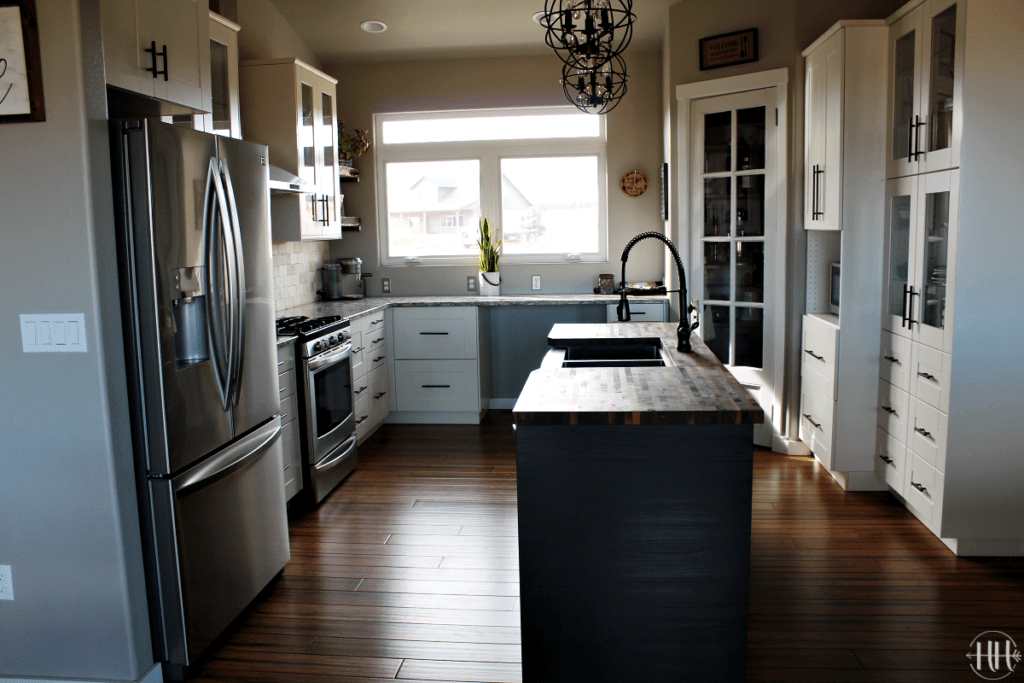 Sammi Ricke's complete view of her white IKEA Sektion kitchen cabinets and black Tingsryd wood island.