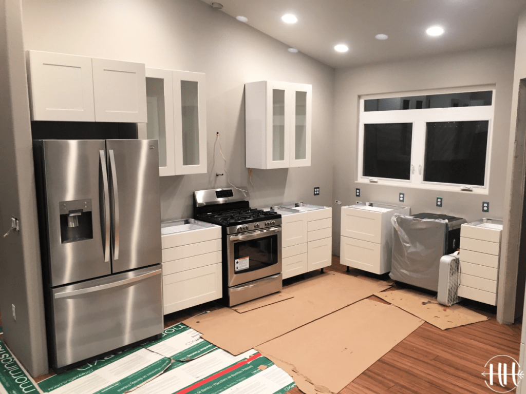 Photo taken at night of cabinets hung in new kitchen.
