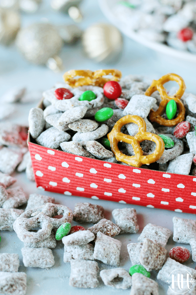 Allergy Friendly Reindeer Chow | This classic Christmas recipe is easy and perfect to give as a gift in a mason jar, set out at a holiday party as a snack, or leave for Santa. Use nut free Sunbutter, gluten free and soy free pretzels and Chex cereal, and dairy free dark chocolate chips in this Muddy Buddies Mix. Kids LOVE this dessert especially with pretzels and red & green M&Ms. Christmas treats that are allergy friendly for kids are hard to come by and this one is delicious and only takes minutes to prepare!