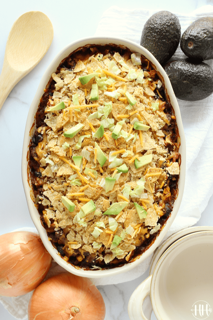 Birds eye view of an easy enchilada casserole in an oblong white baking dish.