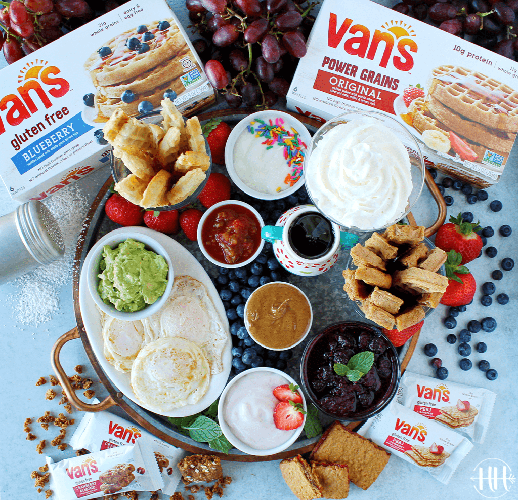 "#ad Serve this Waffle Dippers Board at your next kids party, breakfast, or brunch. Van's frozen waffles are nutritious (gluten free, whole grain-protein packed!, and organic options) and easy to make into ""soldiers"" in this recipe idea. Use a pizza cutter to cut waffles and place on a cookie sheet, tray, or cutting board with sweet and savory dipping options like Greek yogurt, healthy nut butter, maple syrup, fruit compote, homemade whipped cream, ALL the toppings! #VansFoodsWaffles #vansfoods"