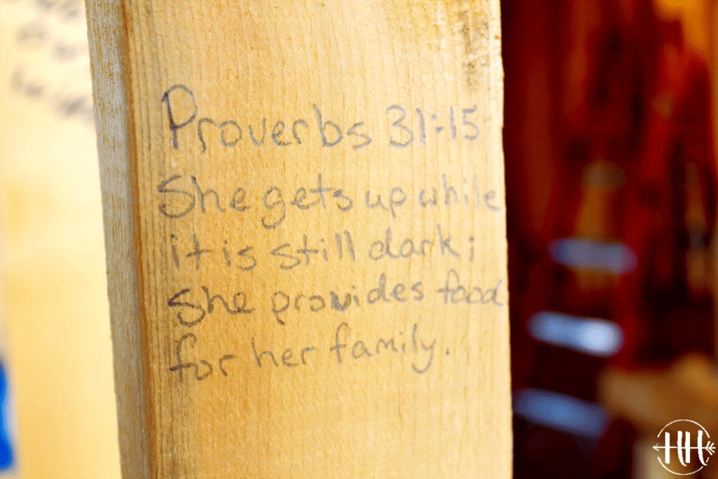 "Proverbs 31:15 ""She gets up while it is still dark; she provides food for her family"" is written on a board in a new kitchen. Bible Verses for a New Home is a way to bring God into your new place of residence."